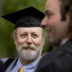 Mike Galvin of Nantucket, Mass., dons son Josh's mortarboard, while admiring his soon-to-be-graduate.