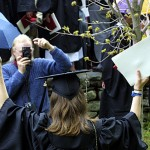 This graduate gives it up for the camera.