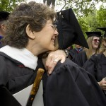 Marcy Plavin, lecturer in dance emerita, offers a warm embrace to a new graduate.