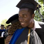 Emmanuel Drabo '08 of Ouagadougou, Burkina Faso (Upper Volta), receives a hug from Assistant Professor of Mathematics Meredith Greer.