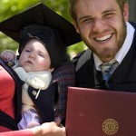 Proud uncle -- and graduate -- Noah Gauthier '08 of Amherst, N.H., poses with niece Audrey Alexander, 3 months, held by her mother and Gauthier's sister, Lauren Alexander.
