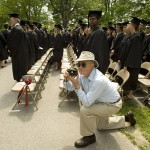 Students proceed in front of Coram Library for Saturday's Baccalaureate ceremony. A dedicated photographer positions himself for the right angle — and the right graduate.