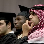 Prayer leaders (from left) David Burns, Jevede Harris and Jamil Zraikat listen to President Hansen's Baccalaureate address.