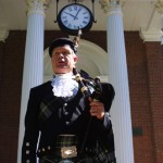 Piper Michael Crosby stands at attention as graduates pass by.