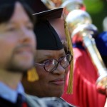 Honorary degree recipients Ken Burns and M. Joycelyn Elders line up for the Commencement procession.