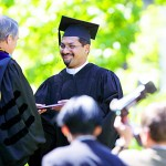 Khurram Khan receives his diploma from President Harward.