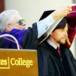 Chairman of the Board of Trustees Burton Harris '59 presents the honorary hood to documentary filmmaker Ken Burns, who received a Doctor of Humane Letters degree.