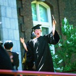 A delighted Justin Stebbins shows off his diploma.