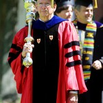 Mace bearer Sawyer Sylvester, professor of sociology, leads the procession.