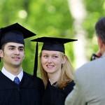 Graduates pose for a formal portrait.