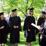 Graduates line up to greet faculty, led by President Donald W. Harward, who will retire June 30 as the sixth president of Bates College.