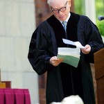 Nobel laureate Steven Weinberg, University of Texas physicist, consults his notes before delivering the Commencement address.