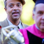 Composer, musician and writer James McBride, convocation speaker, waits for the ceremonial procession to begin, led by macebearer Eli Minkoff, professor of biology.