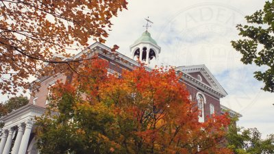 Hathorn Hall surrounded by fall foliage with Bates seal
