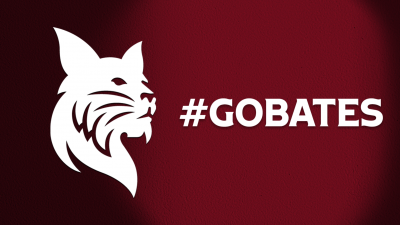 White Bobcat with GoBobcats white text over garnet background with shadow lighting