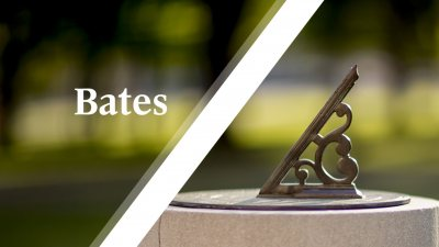 White Bates wordmark over sundial