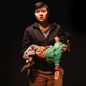 """""""We're not manipulating the puppets to have them do what we want them to do,"""" explains Keila Ching '19 (center) one of five players in the original Sandglass play """"Babylon, Journeys of Refugees,"""" rehearsing in Gannett Theater with actor Raphael Sacks and one of the puppets. . """"We're animating these characters and breathing life into them — it's very much a breath-based approach."""" . Bates College presents two performances by @sandglasstheater of Putney, Vt., on Friday at 7:30 p.m. and Saturday at 5:00 p.m. of this original theatrical work that mixes live actors and puppets to portray the relationship between refugees, their homeland, both lost and new, and the conflicts that arise in the countries to which they flee. . Presented by the Bates Department of Theater and Dance with generous support from numerous partners, both on and off campus, admission is free, with donations accepted, and all are welcome. ------------------------- Actors are Alan R. White (glasses), Shoshana Bass (long hair), Kalob Martinez (brown hair), Raphael Sacks (blond hair) and Keila K. Ching (pronouns: they/them or he/him)"""