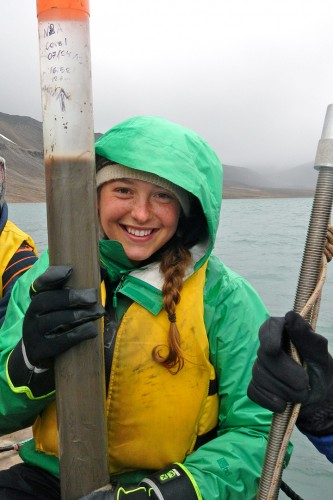 Ali Balter '14 displays her sediment core sample from Lake Lennoré, an Arctic lake in Svalbar, Norway. She did lab analysis of the core in the college's Environmental Geophysical Laboratory. (Photograph by Greg de Wet '11)
