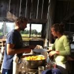 Matt Mosca cutting peaches at King Hill Farm
