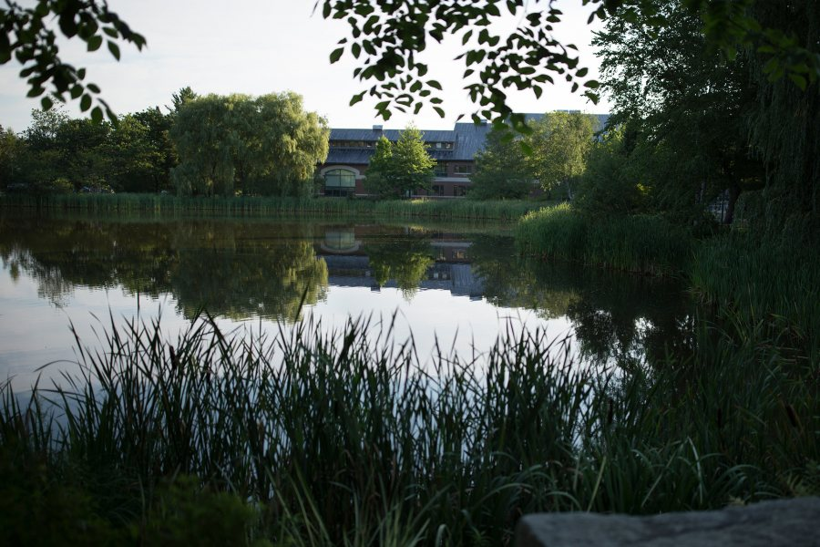 Early summer morning on the Bates campus.Looking across Lake Andrews to Olin Arts Center.