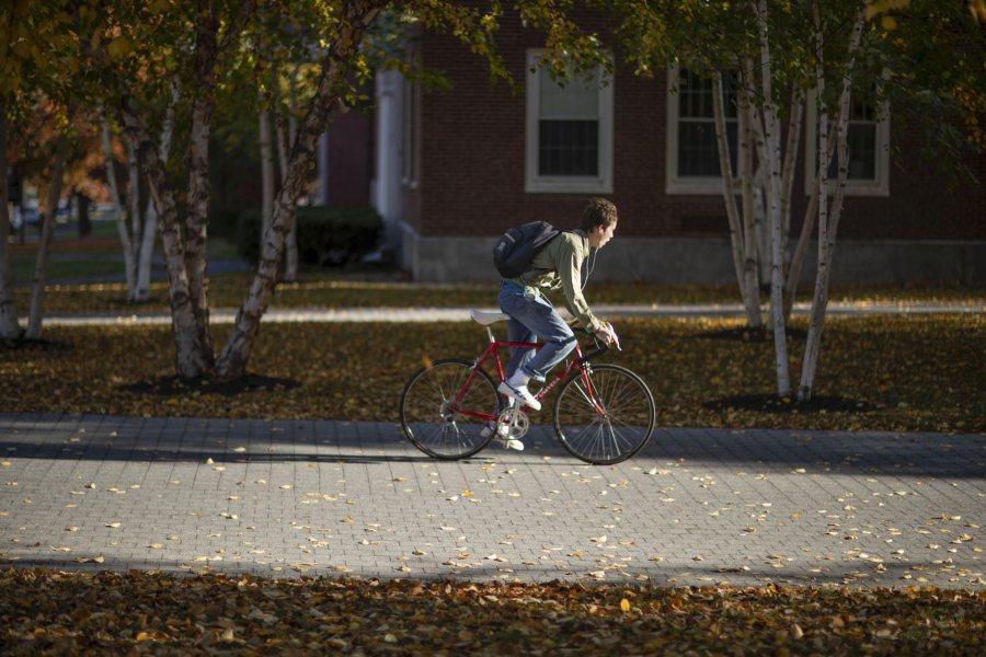 Tuesday morning, Oc. 15, 2019A student bikes down Alumni Walk in front of Pettigrew Hall.