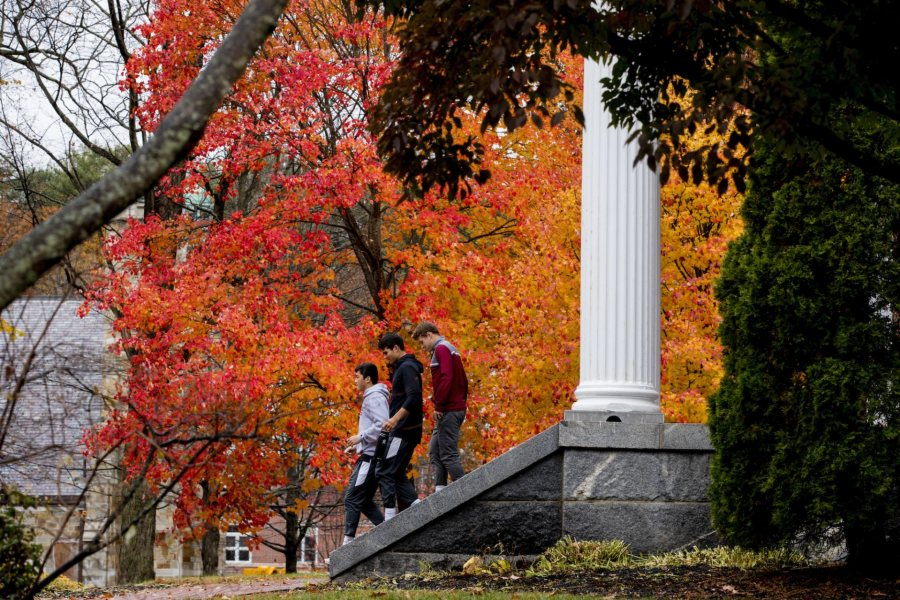 Fall foliage on a rainy, overcast day on the Historic Quad and Alumni Walk.  In gray sweatshirt Ciaran Bardong '22 In multi-colored/red sweatshirt Luke Sedore Protti '22 In black sweatshirt Charlie Cronin '22  Running up and down the stairs of Alumni Walk after asked by the photographer