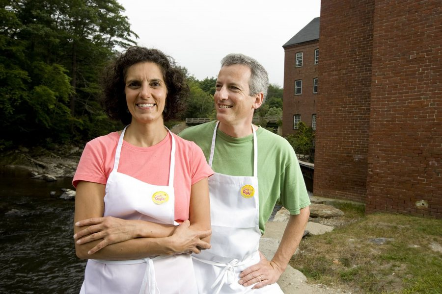 In 2008, Beth George '85 and Tim Kane '85 pose outside their family-owned company, Spelt Right Inc. in the Sparhawk Mill in Yarmouth, Maine. (Phyllis Graber Jensen/Bates College)
