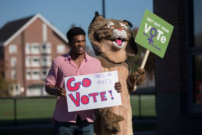 Election Day  Marcus Delpeche '17 of Wilmington, Del., and the Bates Bobcat encourage members of the Bates community to vote today. Inside Commons, students distributed information about six statewide ballot initiatives and recorded the number of students who had voted in today's election.