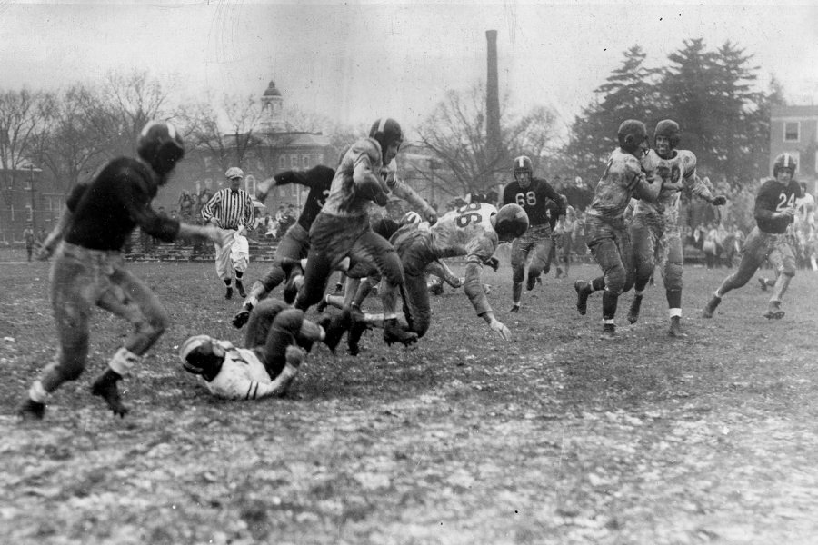 Allen Howlett '49 picks up rushing yardage in Bates' 6-0 win over Bowdoin on rainy, muddy Garcelon Field before 3,000 on Back to Bates weekend on Nov. 2, 1946. (Muskie Archives and Special Collections Library)