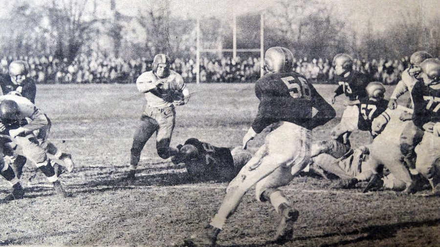 Art Blanchard '47 carries the ball during the Glass Bowl game on Dec. 7, 1946, between Bates and the University of Toledo.