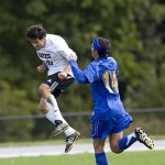 Peter Litwin '10 meets the ball head on during a Saturday morning game against Connecticut College.