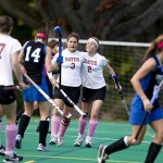 After scoring an unassisted goal, Rachel Greenwood '09 (left) celebrates with Morgan Maciewicz '10. The Bates College field hockey team scored two goals in the first half and held off Connecticut College to earn its first NESCAC win of the season at Campus Avenue Field on Saturday.