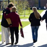 On his way to the locker room, Matt Conetta '12, an offensive lineman for the football team, says goodbye on the Alumni Walkway to mother Carolyn, father Doug and sister Aimee, 21.