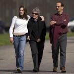 Parents Margaret and David stroll behind Merrill Gymnasium with daughter Dana Lindauer '11.