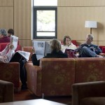 Parents relax during lunch in the Fireplace Lounge of the New Commons Building.