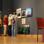 "After a gallery talk given by Mark Bessire, director of the Bates College Museum of Art, visitors enjoy ""Stairway to Heaven,"" an exhibition of contemporary art analyzing the changing streets and urban landscapes of China. Photograph by Louisa Demmitt '09."
