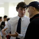 During the poster session, Nicholas Swerdlow '09 discusses his biochemistry research on bacteria that causes Lyme Disease with father Ezra Swerdlow.