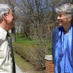 During an April visit, Hansen chats with Dean of Admissions Wylie Mitchell near the 1929 Gates