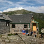Helon Hoffer '08 (right) gives a green-tech tour to hikers outside the Greenleaf hut.