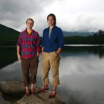 AMC hut croo Carrie Piper '09 (left, of Lonesome Lake) and Eliza O'Neil '09 (right, visiting from the Lakes of the Clouds hut) stand on the shore of Lonesome Lake.