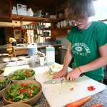 Amelia Harmon '11 chops veggies for the evening meal at the Madison Spring hut.