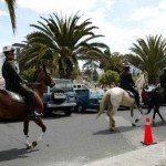 Mounted police patrol an exclusive downtown shopping area on a Sunday afternoon.