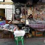 The image of Ché Guevara, still a potent symbol of revolution, is present throughout Latin America. Here his face decorates a poster and music table in the marketplace of Quito's El Centro Histórico.