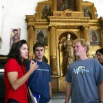 Professor Guerra leads a tour at El Museo de San Francisco, filled with 17th-century religious art.