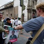Ben Clements '04 asks for a campaign poster (he intends to use it for a class assignment) during a class visit to historic Quito. The candidate pictured, leftist Lucio Gutierrez, won the November 2002 presidential election