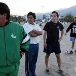 Local players join CBB students, including Bill Spirer '04 (third from left) in choosing sides for an impromptu soccer game in El Parque La Carolina, located in the middle of modern Quito