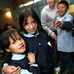 Bowdoin junior Brienne Ahearn poses for the camera with students she tutors at Centro de la Niña Trabajadora, a program in southern Quito for working children of street vendors