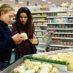 Shopping for Lily's special Friday-night dinner, Kim and her professor inspect cheese at Super Maxi