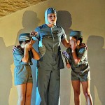 Nurse (Alix Liiv '05) with Children (Krystin Ramick, Alexis Noel) in Brave New World by Aldous Huxley.  Directed by Paul Kuritz.  Set and costume design by Ellen Seeling.  November 2001, Schaeffer Theatre.