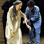 Ma (Saida Cooper '04) and Ma Puppet with Ellen Seeling in The Sea Wall by Marguerite Duras.  Adapted and directed by Seeling.  Set, costume and puppet design by Seeling.  March 2002, Gannett Theater.